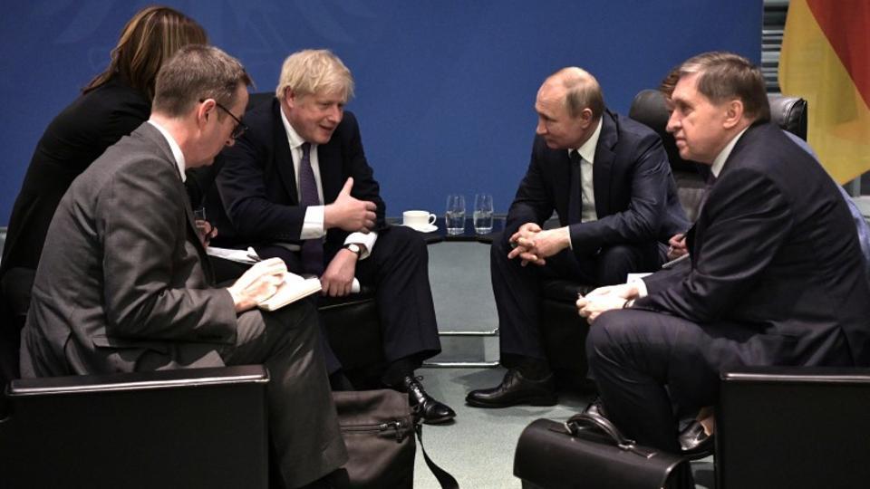Russia's President Vladimir Putin and Britain's Prime Minister Boris Johnson meet on sidelines of the Libya summit in Berlin, Germany on January 19, 2020.