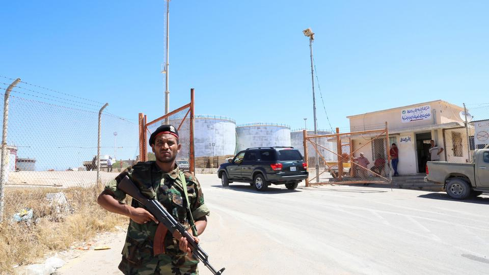 A member of the Petroleum Facilities Guard is seen at the entrance of Azzawiyah Oil Refinery, in Zawiyah west of Tripoli, Libya July 23, 2020.