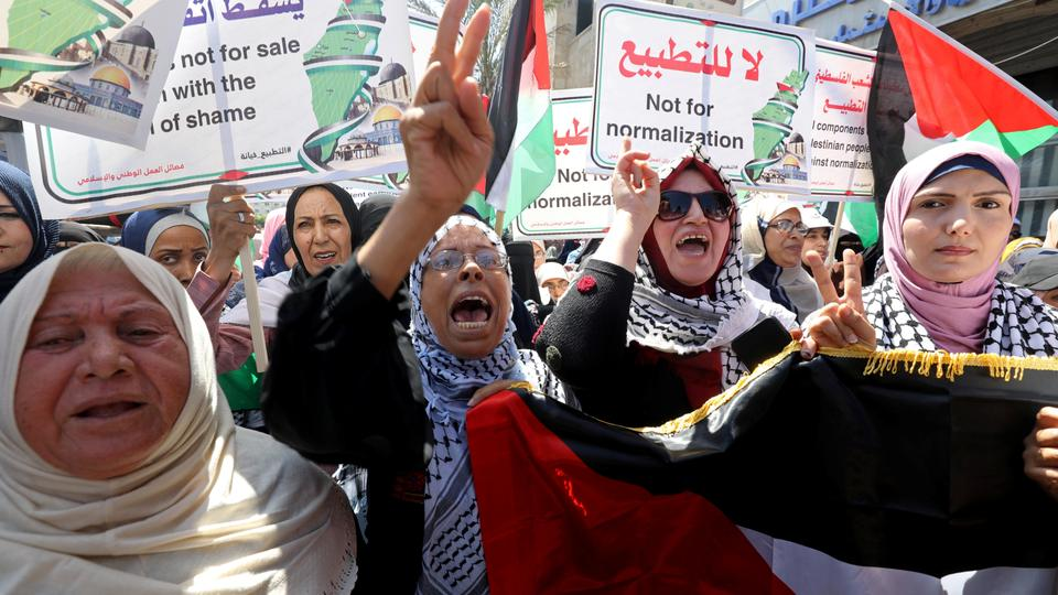 Palestinians take part in a protest against the United Arab Emirates' deal with Israel to normalise relations, in Gaza City, August 19, 2020.