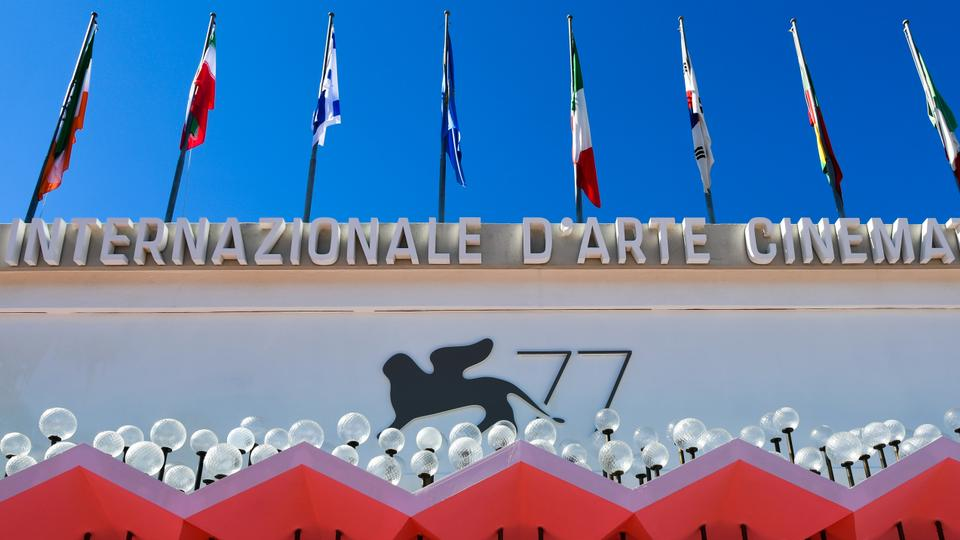 The logo of the 77th Venice Film Festival is pictured on the festival's palace on the eve of the festival's opening, September 1, 2020.