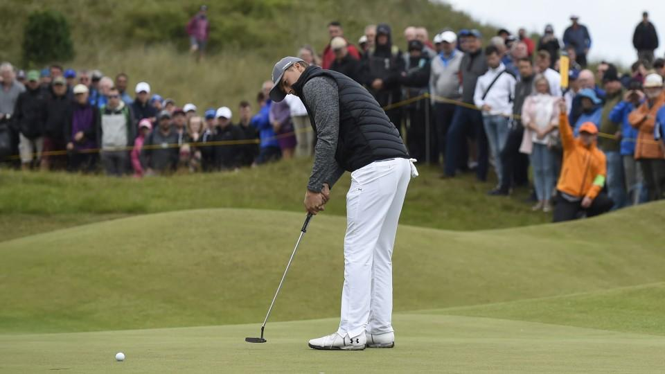 947070f4c4c6bb US golfer Jordan Spieth putts on the third green during his opening round  65 on the