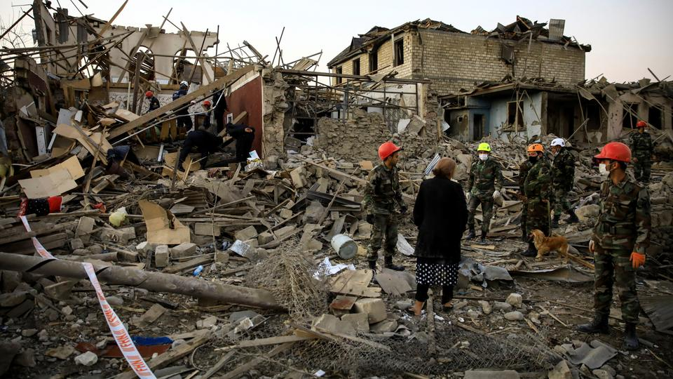 Search-and-rescue teams work on a blast site hit by a rocket in the city of Ganja, Azerbaijan on October 17, 2020.
