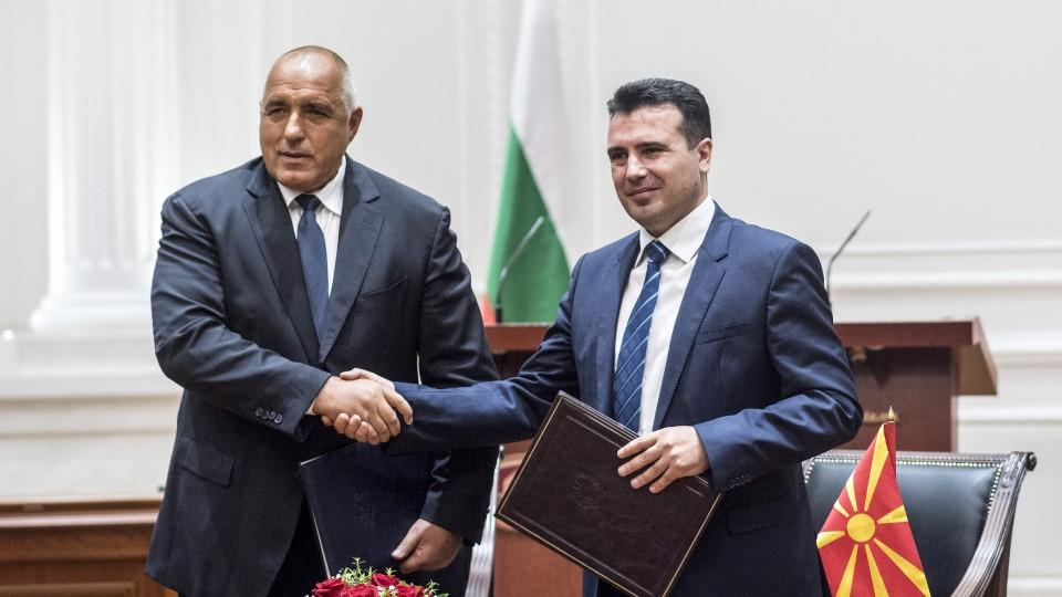 Bulgarian Prime Minister Boyko Borisov (L) and Macedonian Prime Minister Zoran Zaev (R) shake hands during the official signing ceremony of the Neighborhood Agreement between Bulgaria and Macedonia, in Skopje on August 1, 2017.