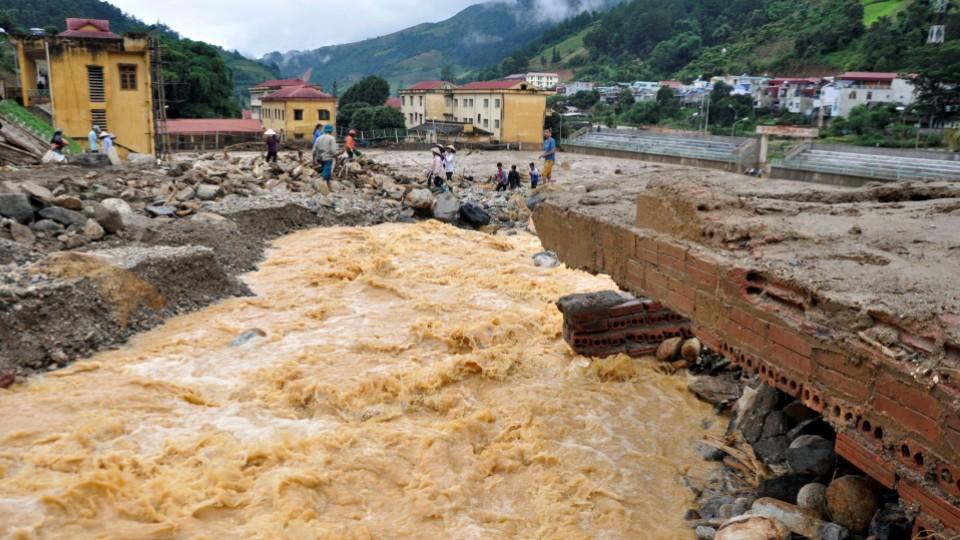 A bridge damaged by floods is seen in Mu Cang Chai district, in northern Yen Bai province, Vietnam, August 4, 2017.