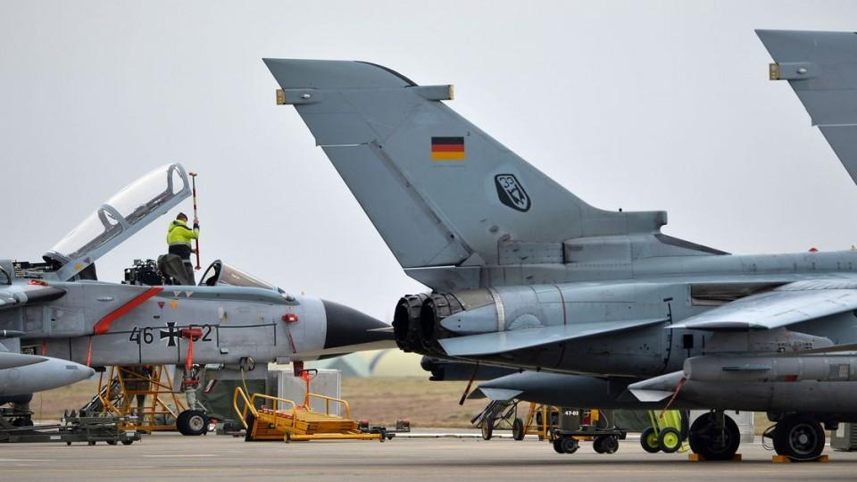 A technician works on a German Tornado jet at the air base in Incirlik, Turkey, January 21, 2016.