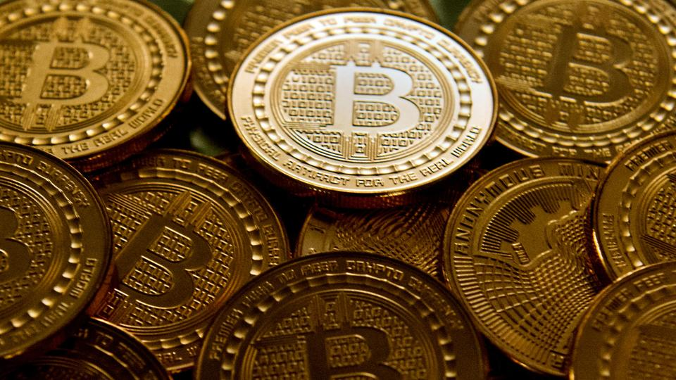 Physical specimens of the bitcoin virtual currency seen in image.
