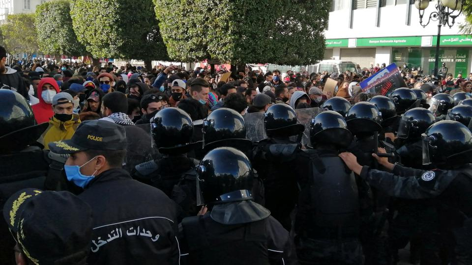 Police officers stand guard as demonstrators take part in an anti-government protest in Tunis, Tunisia, on January 23, 2021.