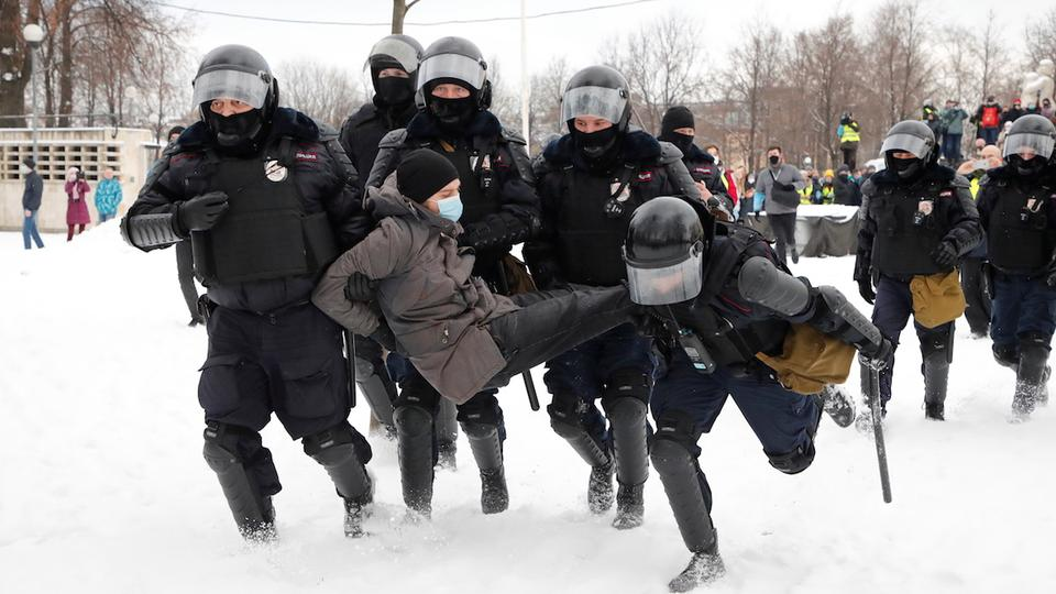 Law enforcement officers detain a man during a rally in support of jailed Russian opposition leader Alexei Navalny in Saint Petersburg, Russia January 31, 2021.