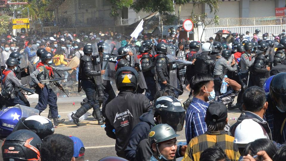 Myanmar anti-coup protesters hit with water cannons, rubber bullets