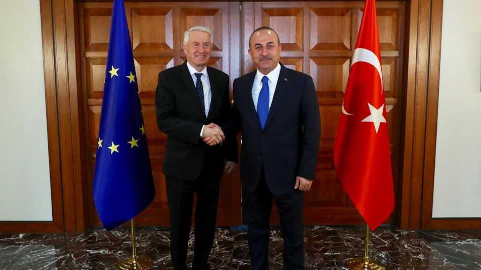 Turkey's Minister of Foreign Affairs, Mevlut Cavusoglu (R) and Secretary General of the Council of Europe Thorbjorn Jagland (L) shakes hands as they pose for a photo at Official Residence of Foreign Ministry in Ankara, Turkey on February 15, 2018.