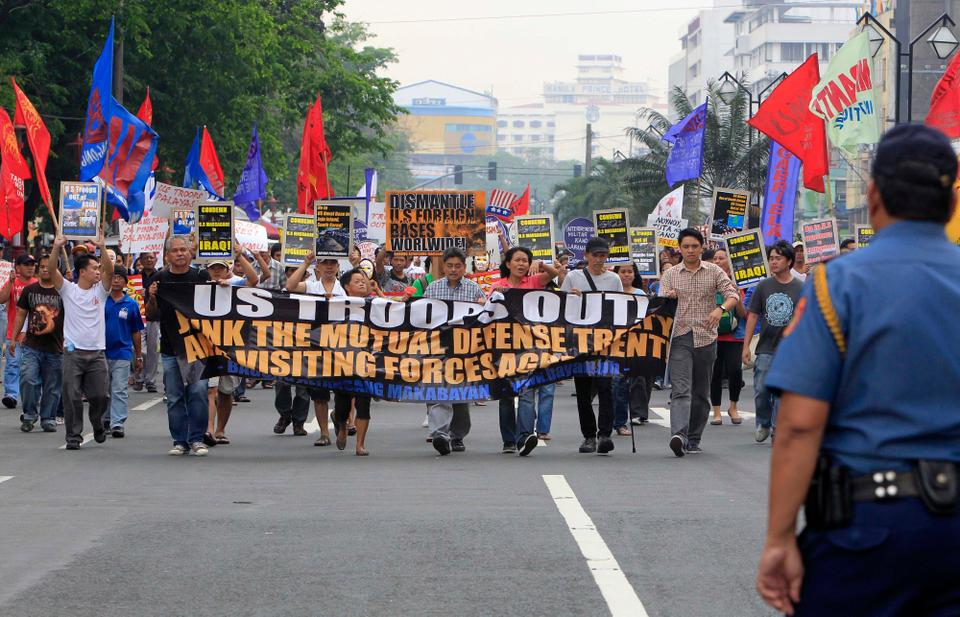 Protesters march towards the US Embassy in Manila, Philippines, March 20, 2012 to commemorate the 9th anniversary of the invasion of Iraq by the US. The protesters also are demanding the pullout of US troops in the Philippines as well as Asia and the Pacific.