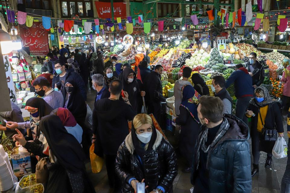 People shop at the Tajrish Bazaar, ahead of Nowruz, the Iranian New Year, amid the coronavirus disease (COVID-19) pandemic, in Tehran, Iran March 17, 2021.