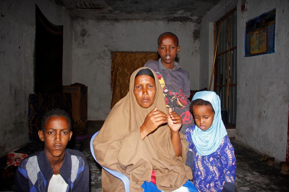 Fadumo Moalim Abdulle poses with 3 of her children, during an interview with the Associated Press in Mogadishu, Somalia, Monday, Jan, 18, 2021. The mother of eight has heard that her twenty year old son, Ahmed Ibrahim Jumaleh is one of the soldiers sent to Eritrea for military training in preparation to fight alongside Ethiopian troops.