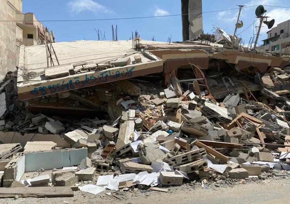 Khatwa company, which shared the Kahil building with the Samir Mansour bookshop and publishing house, spray-painted its number on the rubble after an Israeli air strike turned the building in Gaza into a heap of rubble on May 18, 2021.