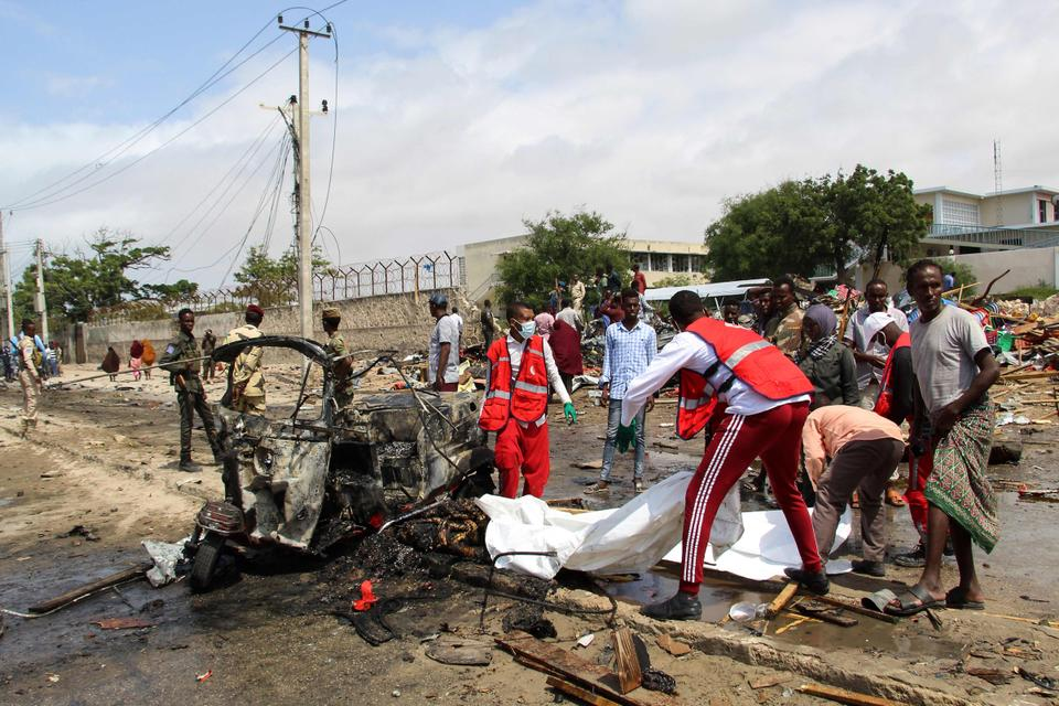 Medical workers arrive at the scene of suicide car bomb attack that targeted the city's police commissioner in Mogadishu, on July 10, 2021.