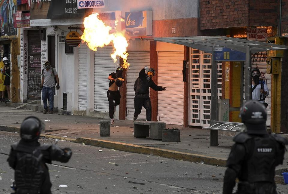 Demonstrators clash with riot police during a protest against the government of Colombian President Ivan Duque in Cali, Colombia on July 20, 2021.