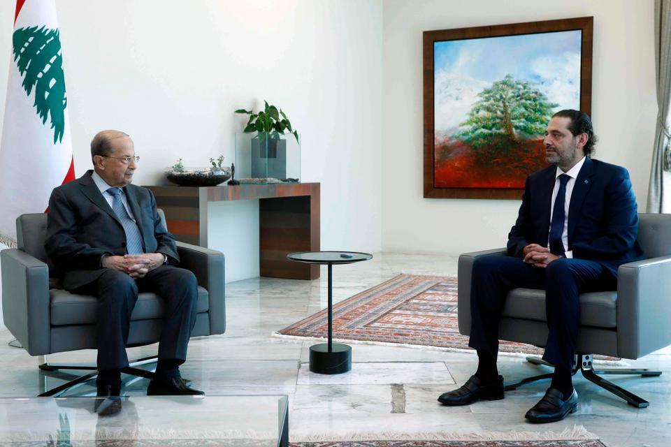 Lebanese President Michel Aoun, left, meets with Lebanese Prime Minister-designate Saad Hariri, at the presidential palace in Beirut, Lebanon on July 14, 2021. Hariri said on July 15 that he is stepping down, nine months after he was named to the post by the parliament, citing key differences with Aoun.