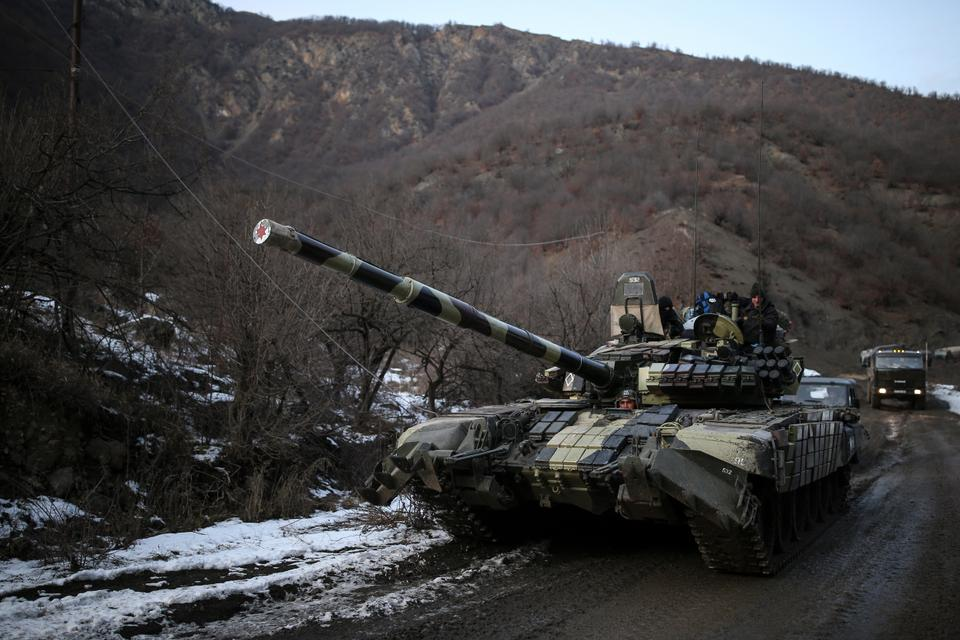 This file photo from December 20, 2020 shows an Azerbaijani tank along a highway, after the transfer of Kalbajar region to Azerbaijan's control, as part of a November peace deal that required Armenian forces to cede Azerbaijani territories they held outside Nagorno-Karabakh, near Kalbajar, Azerbaijan.
