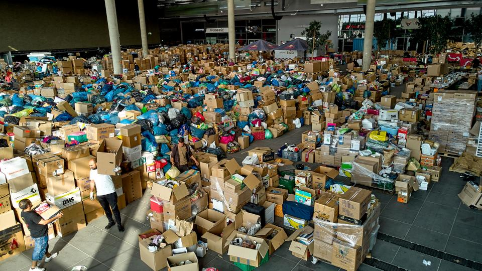 Volunteers sort donations at the donation centre on the Ring Boulevard of Nurburg, Germany, before they are delivered to the flood disaster area, Thursday July 22, 2021.
