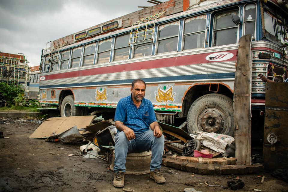 """Farooq Ahmed Mir, 48, a local bus driver claimed drivers have an expenditure of Rs 280,000 ($3,775) per year on their buses which includes insurance and servicing. They used to earn up to Rs 1,500 ($20) a day but after abrogation of article 370, they haven't worked for more than six months for the past two years. """"We had to break down our busses and their parts for scraps. Busses that would cost around Rs 800,000 ($10,800) were sold for Rs 250,000 ($3,370)""""."""