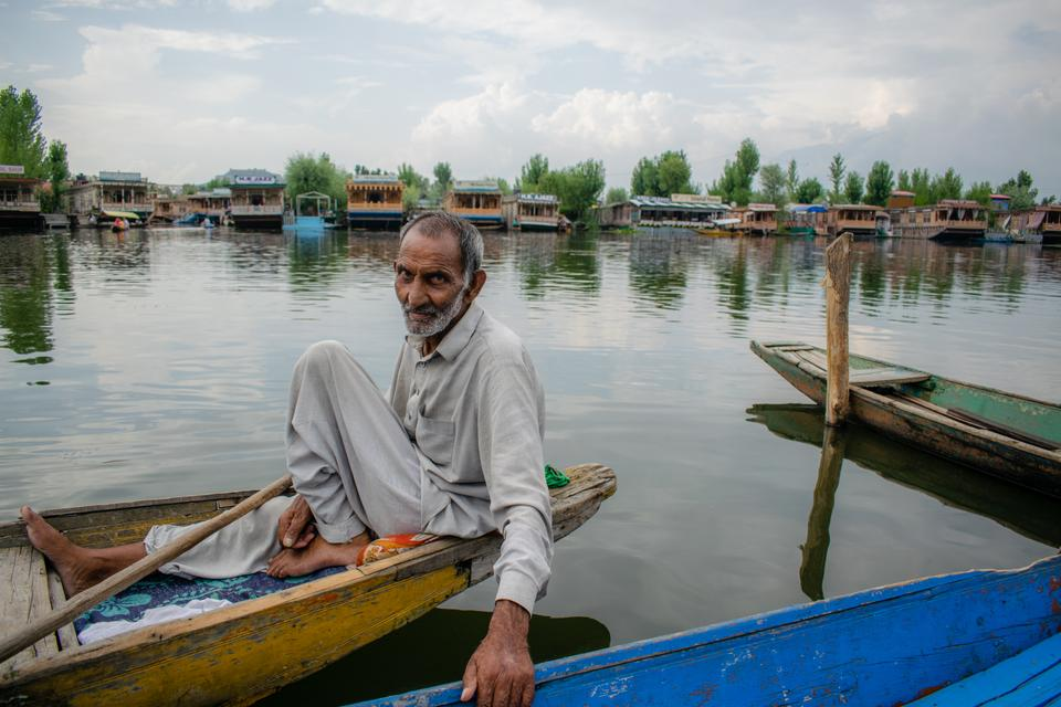 """Ghulam Ahmed Kawa, a 65-year-old boatman used to help people across Dal lake, earning Rs 300-500 ($4-7) a day. He hasn't worked properly for years and is in debt of over Rs 200,000 ($2,700), with no money to repair his damaged boat. Ghulam Ahmad wants his identity to be restored and to """"ban"""" the BJP from Kashmir. """"People in Kashmir are joining BJP due to monetary reasons,"""" he said."""