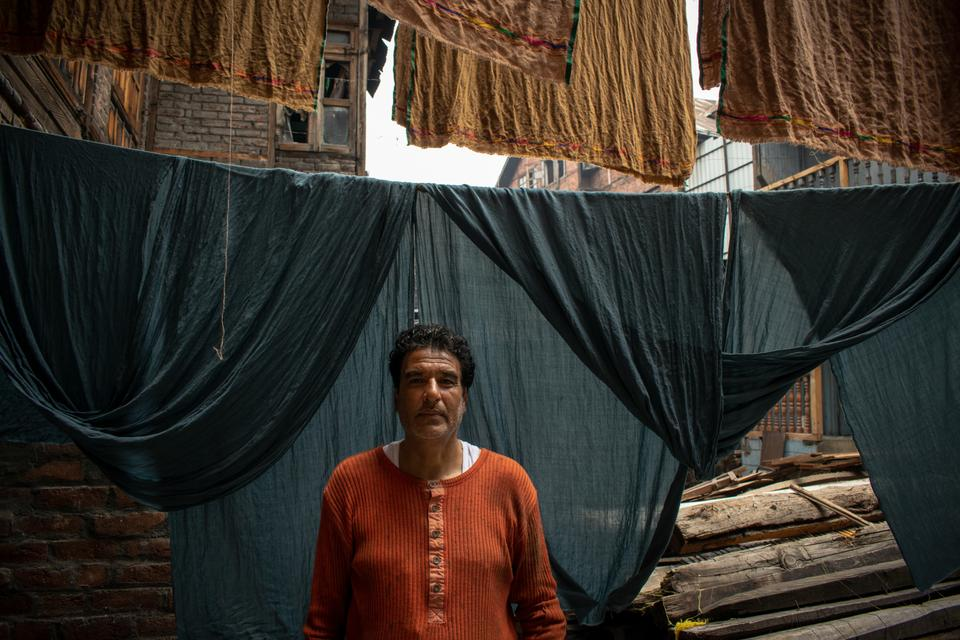 """Mohammad Altaf, 48, is a 3rd generation dyer from Khanyar, Srinagar. He laments about the past two years, saying: """"They will make us jump in river Jhelum and kill ourselves"""". Altaf is under extreme stress as his debt is increasing, he has worked for only 25 days in the last two years, forced to sell his possessions and jewelry belonging to his wife to sustain his family of seven."""