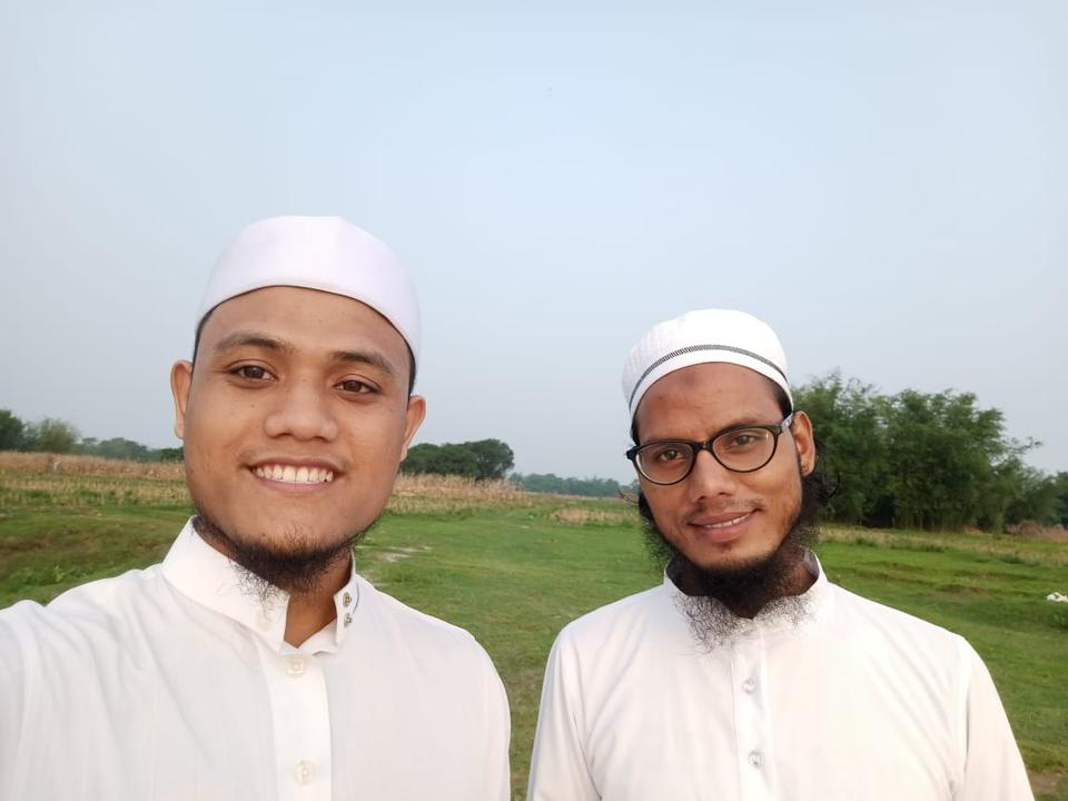 24-year-old Hafizuddin, left, with his friend in Kishanganj, Bihar. Hafizuddin has spent 18 months in India due to a delay in legal proceedings. He was jailed for six months for allegedly violating lockdown guidelines.