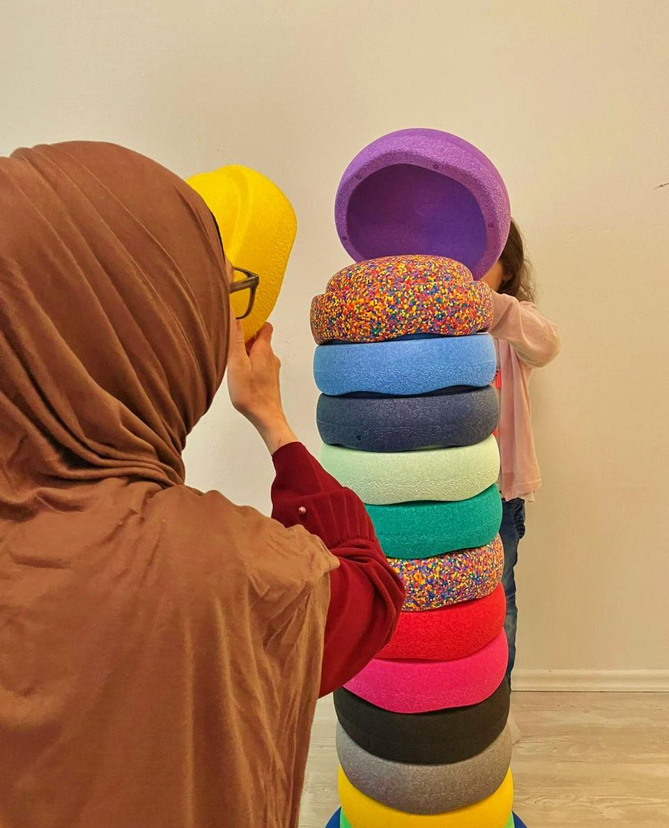 Mariam playing with her daughter at home. The long legal proceedings allowed Mariam to spend some quality time with her young family.