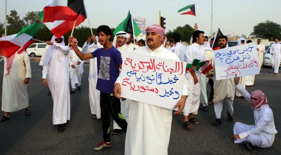 Bidoons take part in a protest to demand citizenship and other basic rights in Jahra, 50 km northwest of Kuwait City, on November 9, 2013. The Bidoon have long been marginalised by the government, their treatment deteriorating significantly from the mid-1980s onwards and the government continuous to block attempts to obtain citizenship.