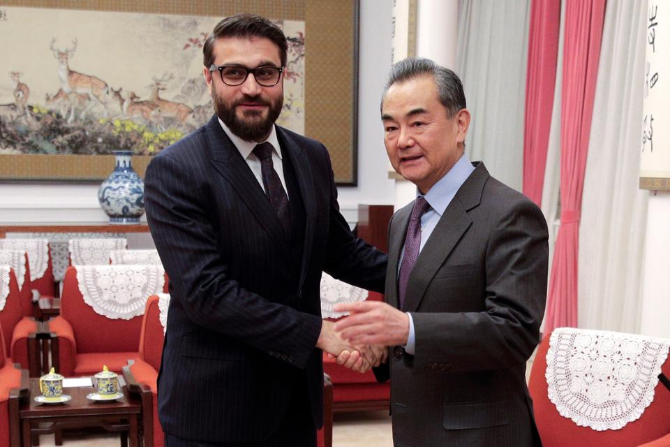 Afghanistan national security adviser Hamdullah Mohib, left, shakes hands with Chinese Foreign Minister Wang Yi before proceeding to their meeting at the Zhongnanhai Leadership Compound in Beijing, January 2019.Although China is investing billions into neighbouring Pakistan, for now it doesn't appear willing to do the same in Afghanistan.