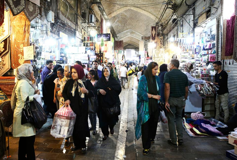 Under both a bad pandemic and US sanctions, Iranian economy is not in a good shape. People walk at the old main bazaar in Tehran, Iran, July 23, 2018.
