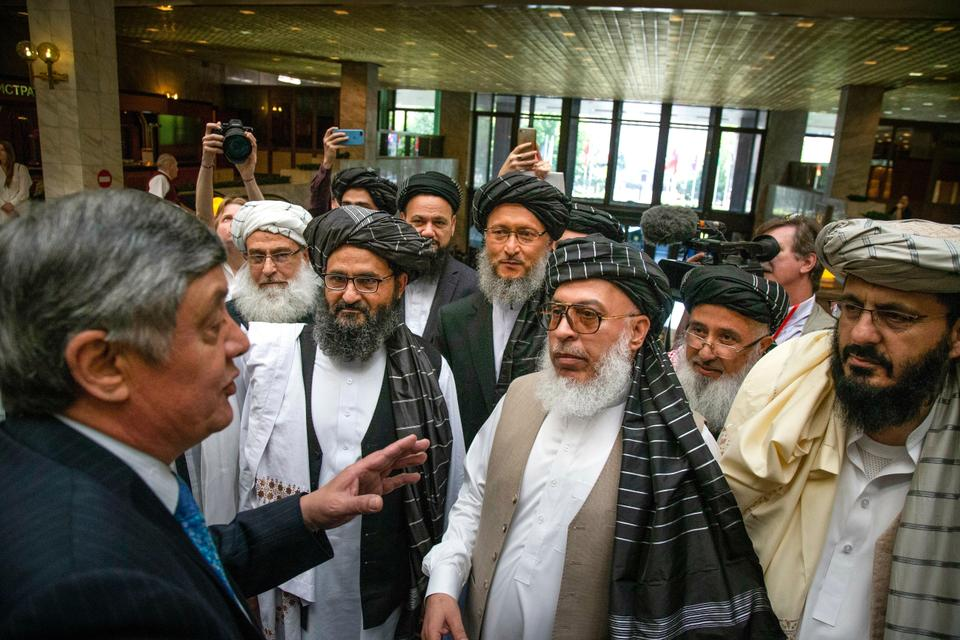 Russia has continuously hosted the Taliban talks, establishing connections with the group's leaders. Russian presidential envoy to Afghanistan Zamir Kabulov, left, speaks to Mullah Abdul Ghani Baradar, the Taliban group's top political leader, third left, in 2019.