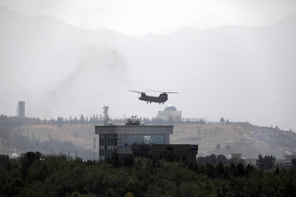 A Chinook lands at the US Embassy in Kabul as diplomatic officials flee the compound amid the Taliban advanced on the Afghan capital.