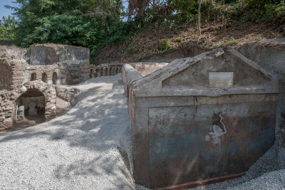 In this undated photo released by the Pompeii archeological park, a view of the tomb of Marcus Venerius Secundio located in the necropolis of Porta Sarno, in an area not yet open to the public in the east of Pompeii's urban center.