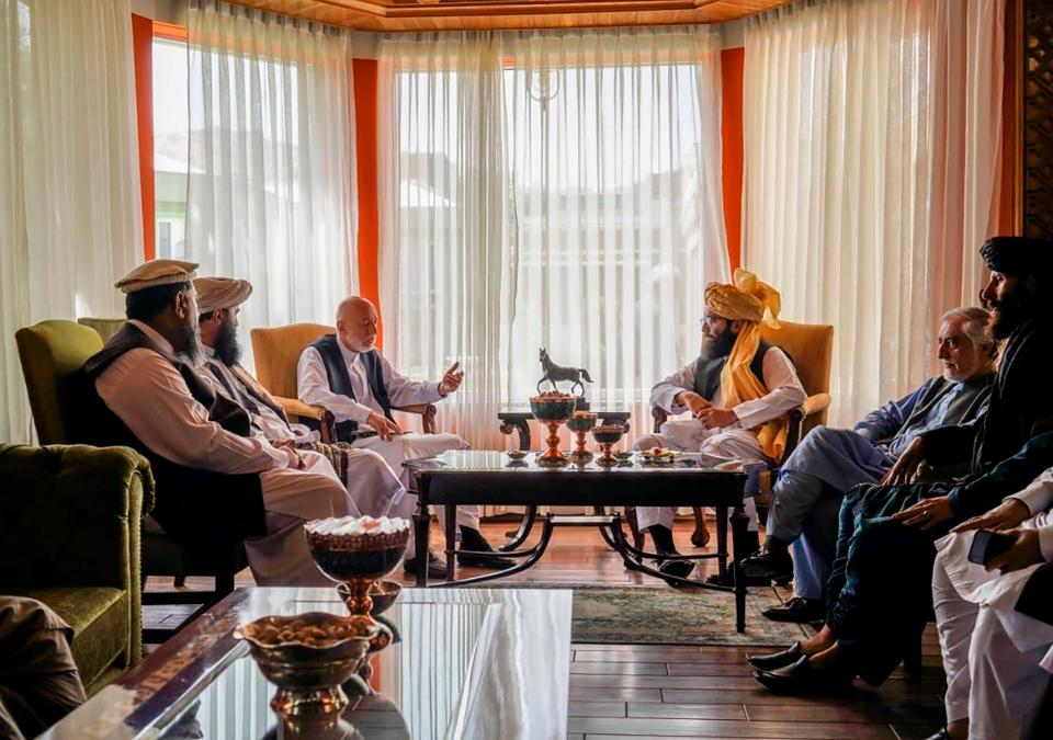 Senior Haqqani group leader Anas Haqqani negotiates with former Afghan President Hamid Karzai, center left, and  Abdullah Abdullah, second right, head of Afghanistan's National Reconciliation Council and former government negotiator with the Taliban on August 18, 2021.