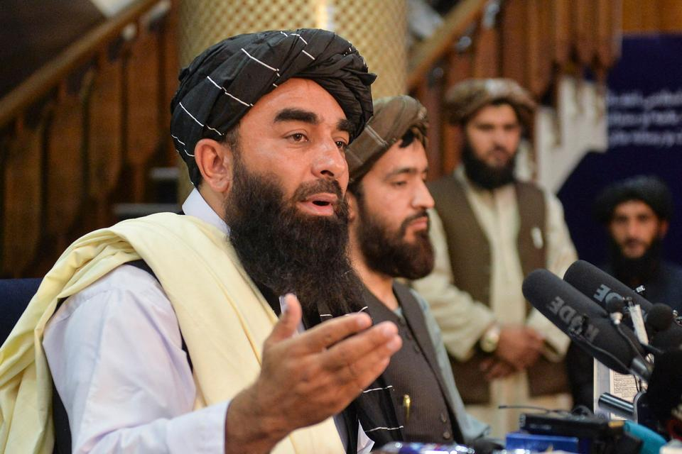 Taliban spokesperson Zabihullah Mujahid (L) suggested that Al Qaeda might stay in Afghanistan after the US withdrawal, according to Abdul Sayed, an independent security expert.
