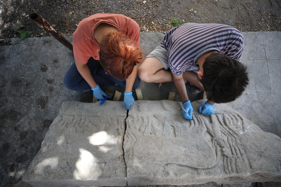 Archaeologists from Dr Iren's team work on the relief depicting the Greco-Persian Wars.