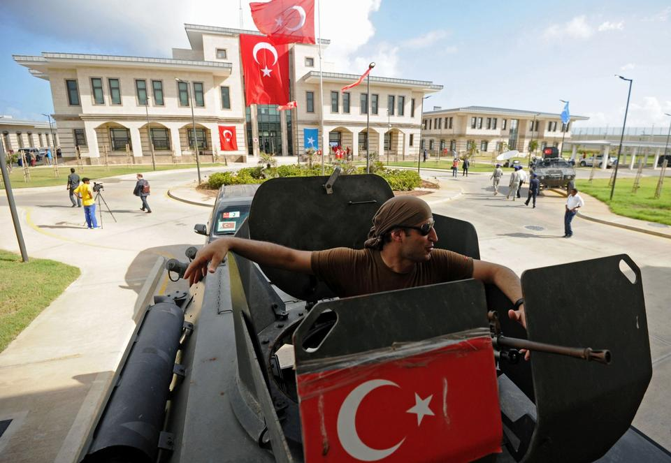 A member of the Turkish security forces sits inside an armored vehicle near the newly opened Turkish embassy in Mogadishu on June 3, 2016.