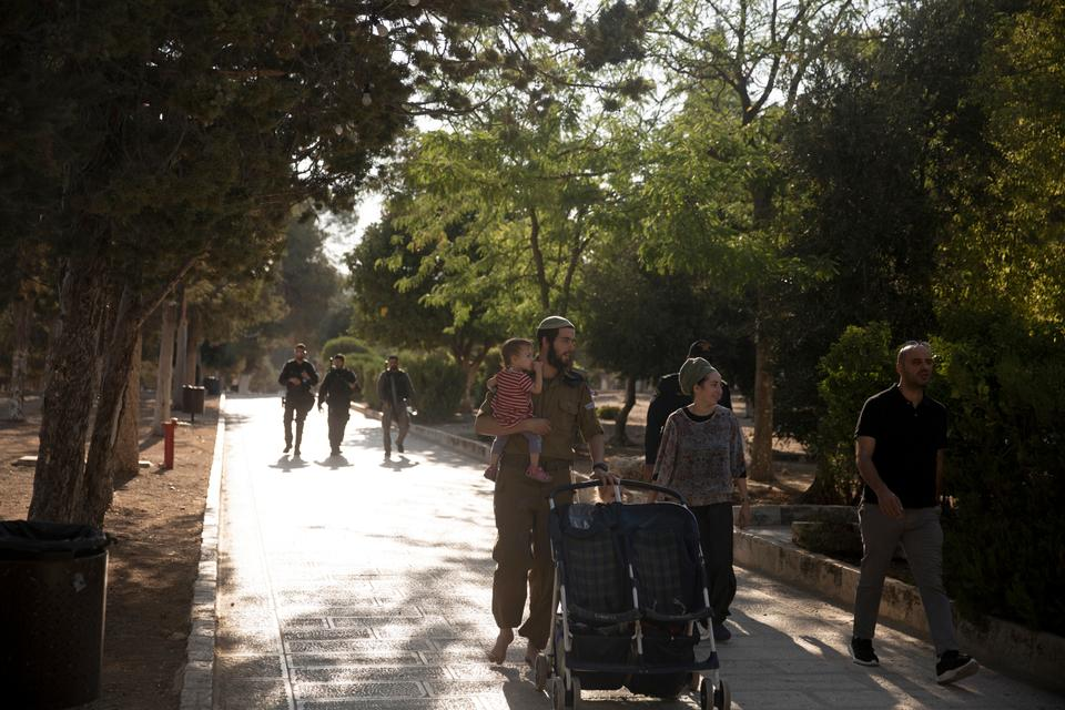 Israeli police escort a Jewish couple strolling the grounds of the Noble Sanctuary, known to Jews as the Temple Mount, compound in the Old City of Jerusalem, Tuesday, Aug. 3, 2021.