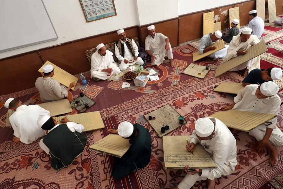 Muslim students study Koran at the Sufi mosque in Tripoli's coastal city of Zliten, 150 kilometres east of the Libyan capital, which is also a Sufi institute offering religious education and free accommodation.
