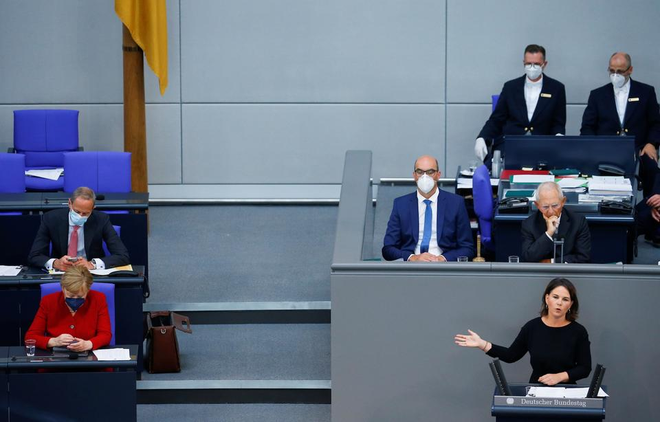 Annalena Baerbock, candidate for chancellor and federal chairwoman of Buendnis 90/Die Gruenen, speaks on the situation in Afghanistan at the lower house of parliament, the Bundestag, in Berlin, Germany, August 25, 2021.