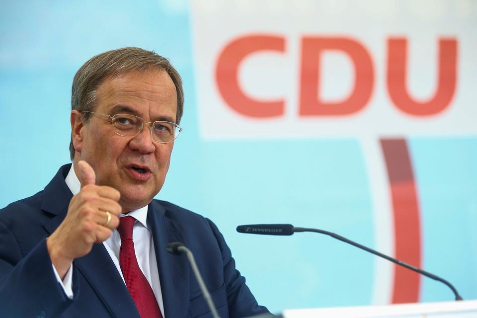 Armin Laschet, CDU/CSU candidate for Chancellor, CDU Federal Chairman and Minister President of North Rhine-Westphalia, gestures as he speaks during an election rally in a beer garden in Korschenbroich, Germany, August 26, 2021.