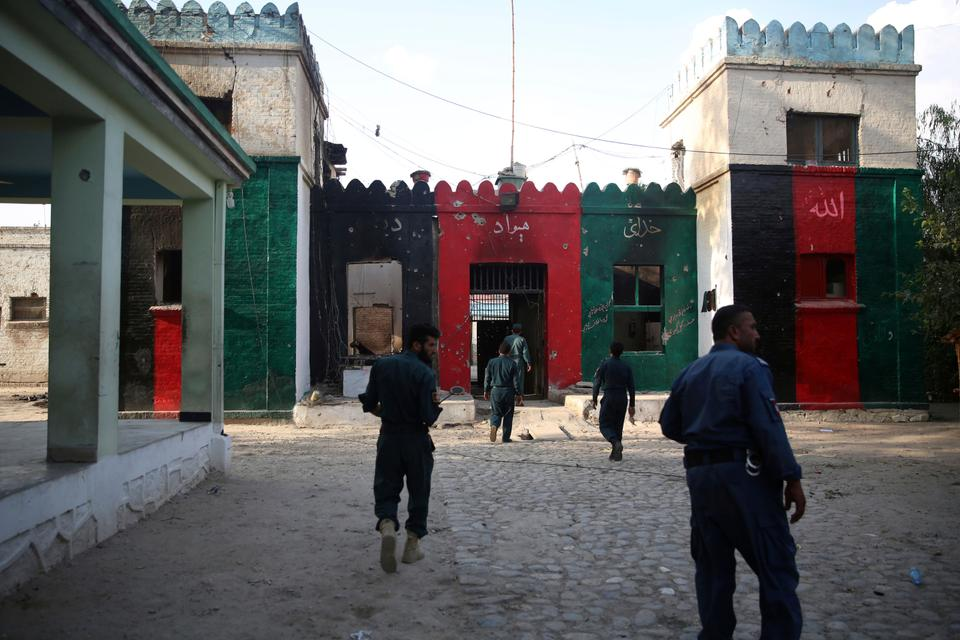 The Taliban released many Daesh and Al Qaeda-affiliated prisoners during its campaign to claim Afghanistan. Former Afghan government security personnels gather inside a prison after an attack in the city of Jalalabad, east of Kabul, Afghanistan, Aug. 3, 2020.