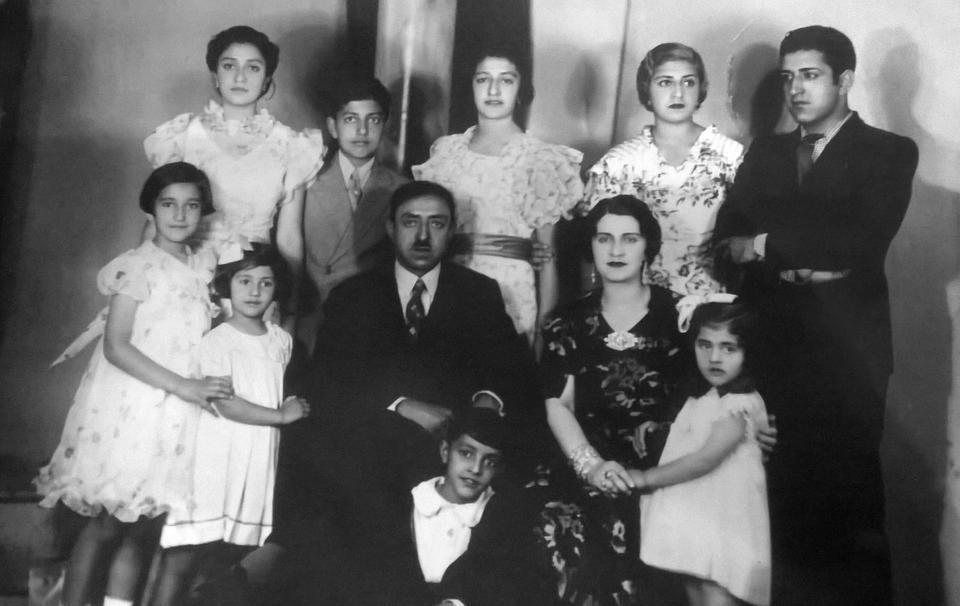Amanullah Khan and his family, Rome, 1933. From left to right, respectively: Abeda, Rahmatullah, Meliha, Amina, Hedayatullah, Adela, India, Amanullah Khan, Soraya Tarzi, Naciye, Ehsanullah.