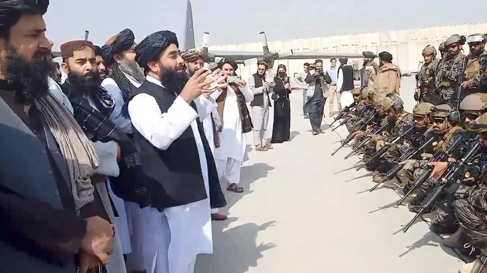 Taliban spokesman Zabihullah Mujahid speaks to Badri 313 military unit at Kabul's airport