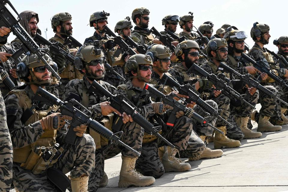 Taliban Badri special force fighters take a position at the airport in Kabul