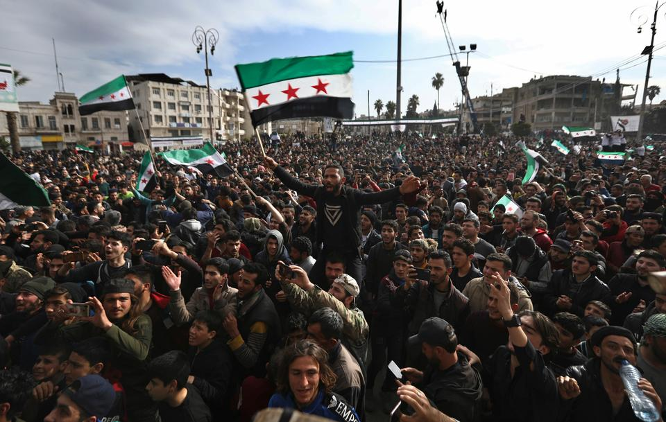 Thousands of people protest against Bashar al Assad's rule in Idlib, the last opposition enclave, as they mark the tenth anniversary of the uprising on March 15, 2021.