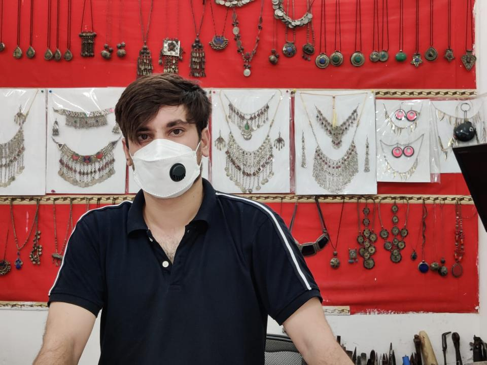 Azidi's jewellery shop in New Delhi is struggling to break even but he prefers to face losses in business than risking his life by returning to Afghanistan under Taliban rule.