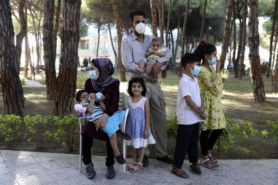 An Afghan family gather at a resort which is accommodated Afghan refugees in Golem, 45 kilometres (30 miles) west of the capital Tirana, Friday, Aug. 27, 2021.