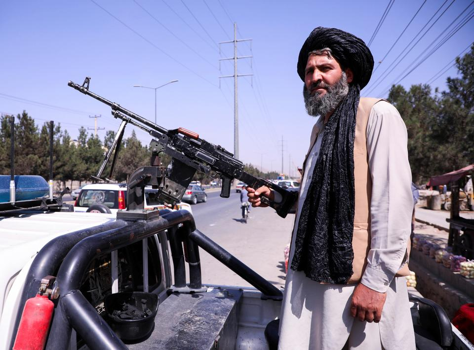 A member of the Taliban force stands guard at a checkpoint in Kabul, Afghanistan, on September 2, 2021.